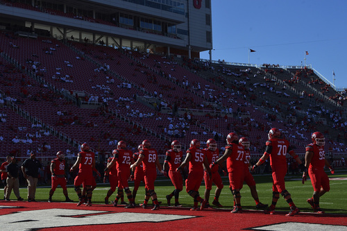 Chris Detrick  |  The Salt Lake Tribune Members of the Utah football team warm up before the game against Idaho State at Rice-Eccles stadium Thursday August 28, 2014.
