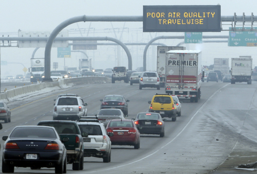 FILE - This Jan. 23, 2013, file photo, shows a poor air quality sign is posted over a highway, in Salt Lake City. Carbon dioxide levels in the atmosphere reached a record high in 2013 as increasing levels of man-made pollution transform the planet, the U.N. weather agency said Tuesday, Sept. 9, 2014. (AP Photo/Rick Bowmer, File)