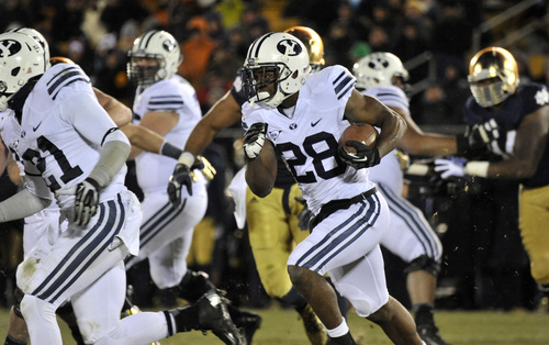 Brigham Young running back Adam Hine heads up field in the second half of an NCAA college football game Saturday, Nov. 23, 2013, in South Bend, Ind. Notre Dame won 23-13. (AP Photo/Joe Raymond)