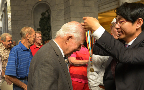 Leah Hogsten  |  The Salt Lake Tribune J. Frank Bonell receives his honorary medal. One hundred eighty one Korean War veterans were presented with a medal from the government of The Republic of Korea and recognized for their service, Wednesday, September 10, 2014 in the Utah Capitol rotunda.