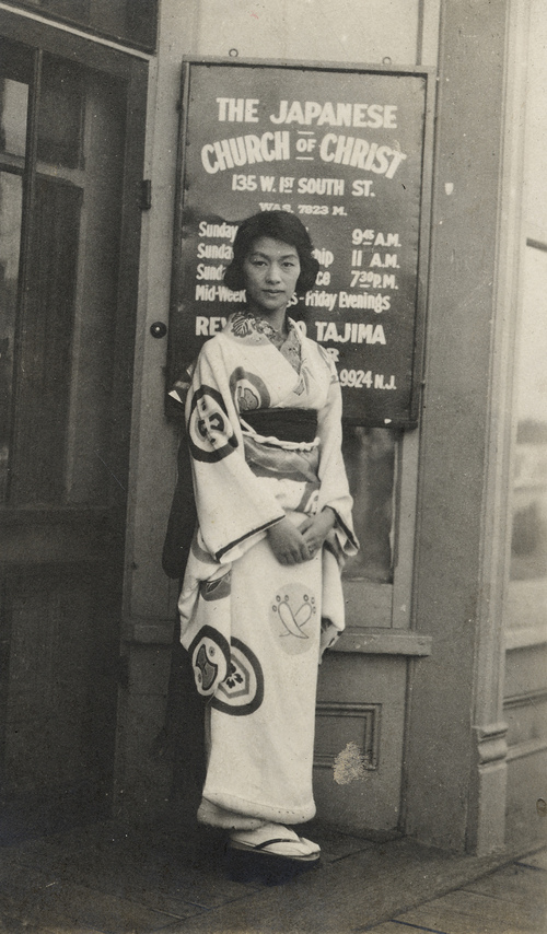 | Courtesy J. Willard Marriott Library Special Collections  An unidentified woman stands in front of the original location of the Japanese Church of Christ in Salt Lake City's Japantown, circa early 1920's.