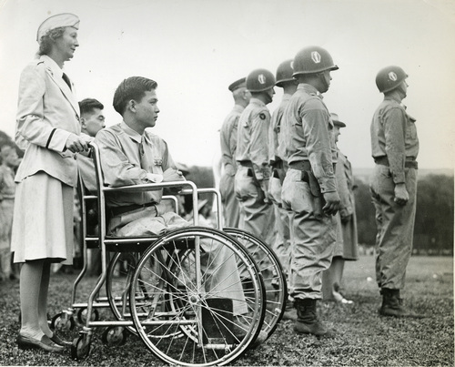 Courtesy J. Willard Marriott Library Special Collections Private First Class Terry Cato of Hawaii watches as Lt. Colonel Alfred A. Pursall and a group of officer of the 442nd Regimental Combat Team stand at attention as a parade in Washington D.C. on July 15, 1946. Private Kato was wounded four times in one day of action in Italy.