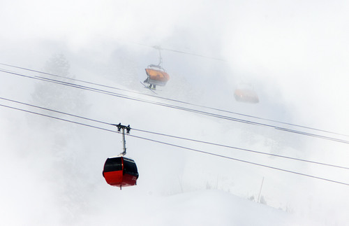 Steve Griffin | The Salt Lake Tribune  Skiers brave sub-zero temperatures as a gondola passes through clouds of man-made snow at the Canyons Resort in Park City, Utah Monday January 14, 2013.