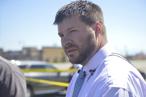 Chris Detrick     The Salt Lake Tribune Saratoga Springs Public Relations Manager Owen M. Jackson speaks at the scene outside of a Panda Express in Saratoga Springs Wednesday September 10, 2014.  A male -- who reportedly was seen wielding a samurai sword -- was shot and killed by police in Saratoga Springs on Wednesday morning.