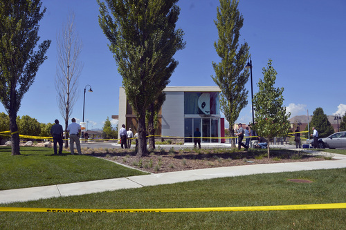Chris Detrick     The Salt Lake Tribune The scene outside of a Panda Express in Saratoga Springs Wednesday September 10, 2014.  A male -- who reportedly was seen wielding a samurai sword -- was shot and killed by police in Saratoga Springs on Wednesday morning.