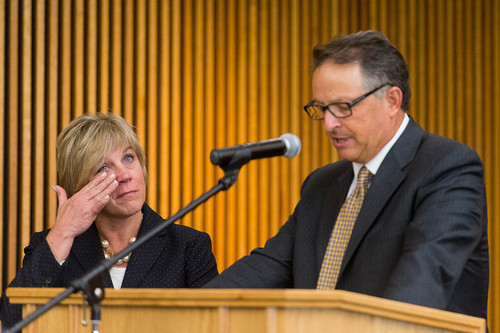 Trent Nelson  |  The Salt Lake Tribune Dr. Deneece G. Huftalin, left, wipes away a tear after being named the new President of Salt Lake Community College as she's introduced by Daniel Campbell, Chair of the Utah State Board of Regents, Thursday September 11, 2014.
