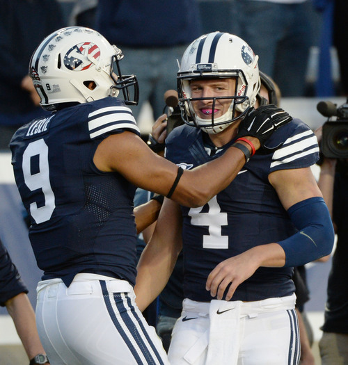 Steve Griffin  |  The Salt Lake Tribune   BYU Cougars quarterback Taysom Hill (4) is congratulated by teammate BYU Cougars wide receiver Jordan Leslie (9) after Hill ran for a touchdown during game between BYU and Houston and LaVell Edwards Stadium in Provo, Thursday, September 11, 2014.