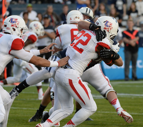 Steve Griffin  |  The Salt Lake Tribune   BYU Cougars linebacker Zac Stout (47) wraps up Houston Cougars running back Ryan Jackson (22) bringing him down for a safety during game between BYU and Houston and LaVell Edwards Stadium in Provo, Thursday, September 11, 2014.