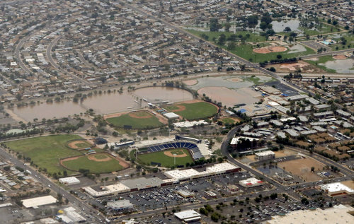 A section of the Milwaukee Brewers' spring training facility is under water following heavy rains and flooding that left motorists stranded during their morning commute on Monday, Sept. 8, 2014 in Phoenix. Monday's record breaking rainfall flooded several Phoenix-area freeways and local streets forcing closures with some areas reporting up to five inches of rain. (AP Photo/Matt York)