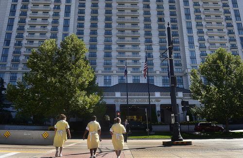 Scott Sommerdorf   |  The Salt Lake Tribune Three maids cross Main Street from the Little America Hotel to the Grand America Hotel in downtown Salt Lake City, Wednesday, September 10, 2014.