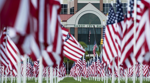 Steve Griffin  |  The Salt Lake Tribune   Over 3,000 seven-foot- tall U.S. flags sway in the breeze outside Sandy City Hall in Sandy, Utah, Wednesday, September 10, 2014.  Homes for Heroes and the Colonial Flag Foundation have sponsored Utah's 13th Annual Healing Field flag display to honor and remember the victims of the 9/11 terrorist attacks. Each flag representing a life lost in horrific attacks.