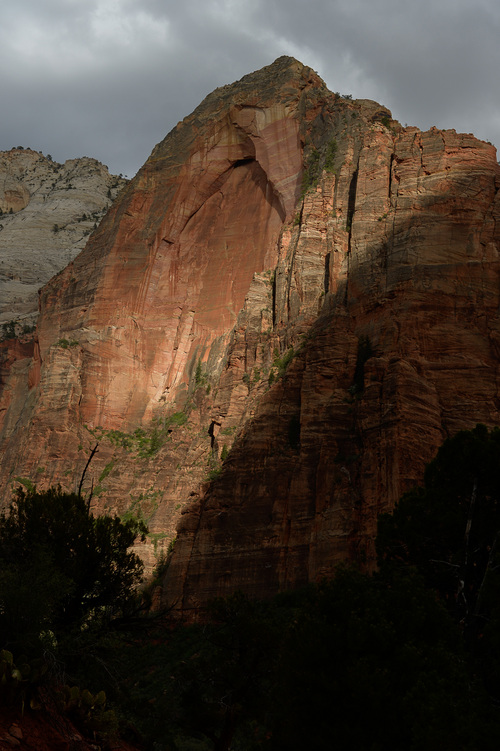 Franciso Kjolseth  |  The Salt Lake Tribune Steep cliffs undergo a constant transformation as the sun flashes through clouds, illuminating the famed landscape along Zion Canyon.