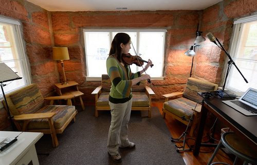 Franciso Kjolseth  |  The Salt Lake Tribune Rachel Panitch, a musician from Boston, composes music in one of the rooms of the historic Grotto at Zion National Park. The sandstone building which was once the original visitors center now acts as the housing for the Artist in Residence Program.