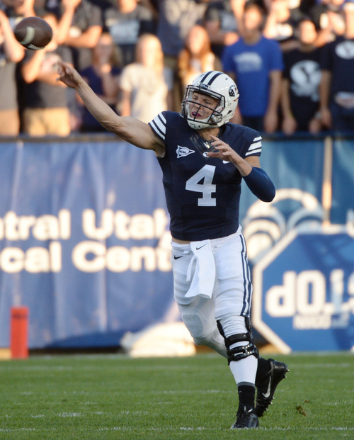 Steve Griffin  |  The Salt Lake Tribune   BYU Cougars quarterback Taysom Hill (4) fires a pass downfield during game between BYU and Houston and LaVell Edwards Stadium in Provo, Thursday, September 11, 2014.