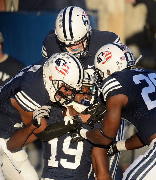 Steve Griffin  |  The Salt Lake Tribune   BYU Cougars wide receiver Devon Blackmon (19) is mobbed by his teammates after getting into the end zone during game between BYU and Houston and LaVell Edwards Stadium in Provo, Thursday, September 11, 2014. The play was called back because of a penalty.