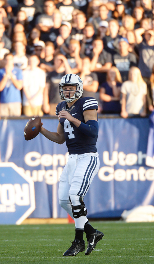 Steve Griffin  |  The Salt Lake Tribune   BYU Cougars quarterback Taysom Hill (4) looks for a receiver during game between BYU and Houston and LaVell Edwards Stadium in Provo, Thursday, September 11, 2014.