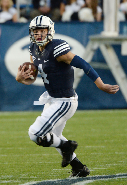 Steve Griffin     The Salt Lake Tribune   BYU Cougars quarterback Taysom Hill (4) heads up field for a touchdown during game between BYU and Houston and LaVell Edwards Stadium in Provo, Thursday, September 11, 2014.