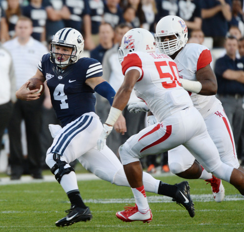 Steve Griffin  |  The Salt Lake Tribune   BYU Cougars quarterback Taysom Hill (4) runs around the end during game between BYU and Houston and LaVell Edwards Stadium in Provo, Thursday, September 11, 2014.