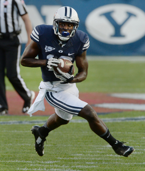 Steve Griffin  |  The Salt Lake Tribune   BYU Cougars wide receiver Devon Blackmon (19) runs upfield after catching a pass during game between BYU and Houston and LaVell Edwards Stadium in Provo, Thursday, September 11, 2014.
