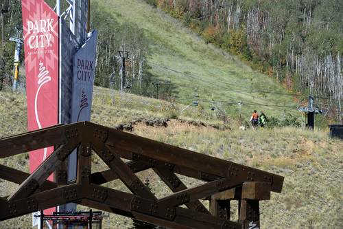 Scott Sommerdorf   |  The Salt Lake Tribune A couple hikes with a dog at Park City Mountain Resort, Thursday, September 11, 2014, the day Vail purchased PCMR for $182.5 million