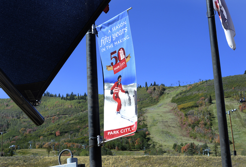 "Scott Sommerdorf   |  The Salt Lake Tribune Signs touting ""A Season 50 Years In The Making"" fly at the base of the hill at Park City Mountain Resort, Thursday, Sept. 11, 2014, the day Vail purchased PCMR for $182.5 million"