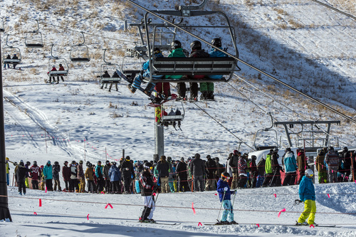 Chris Detrick  |  The Salt Lake Tribune Skiers and snowboarders ride the First Time lift at Park City Mountain Resort Saturday November 23, 2013. Park City Mountain Resort opening day marks 50 years in business.