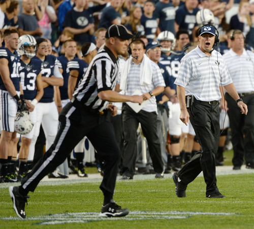 Steve Griffin  |  The Salt Lake Tribune   BYU head coach Bronco Mendenhall walks onto the field after officials called a penalty on BYU during game between BYU and Houston and LaVell Edwards Stadium in Provo, Thursday, September 11, 2014.