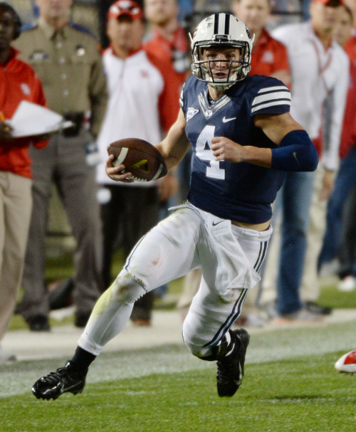 Steve Griffin  |  The Salt Lake Tribune   BYU Cougars quarterback Taysom Hill (4) runs along the sideline in the second half of the  game between BYU and Houston and LaVell Edwards Stadium in Provo, Thursday, September 11, 2014.