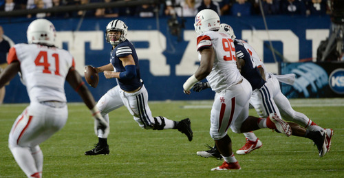 Steve Griffin  |  The Salt Lake Tribune   BYU Cougars quarterback Taysom Hill (4) scrambles out of the pocket as he looks to run in the second half of the  game between BYU and Houston and LaVell Edwards Stadium in Provo, Thursday, September 11, 2014.