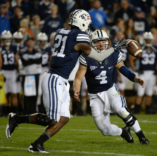 Steve Griffin  |  The Salt Lake Tribune   BYU Cougars quarterback Taysom Hill (4) pitches the ball to BYU Cougars running back Jamaal Williams (21) in the second half of the  game between BYU and Houston and LaVell Edwards Stadium in Provo, Thursday, September 11, 2014.