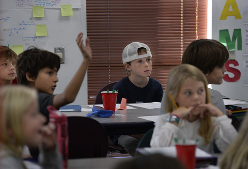 Scott Sommerdorf   |  The Salt Lake Tribune Cole Urmann, center, switched to Salt Lake Arts Academy because the fifth-grade classes at his old school, Wasatch Elementary, were too large. Here he participates in Dan Armstrong's Math5 class at Salt Lake Arts Academy, Wednesday, September 10, 2014.