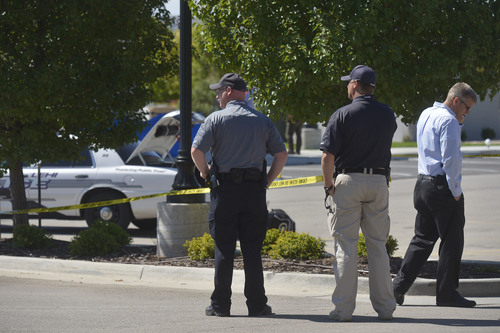 Chris Detrick  |  The Salt Lake Tribune The scene outside of a Panda Express in Saratoga Springs Wednesday September 10, 2014.  A male -- who reportedly was seen wielding a samurai sword -- was shot and killed by police in Saratoga Springs on Wednesday morning.