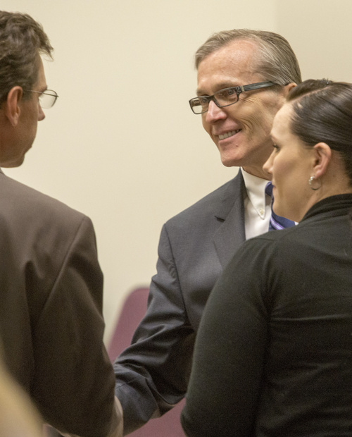 Rick Egan  |  The Salt Lake Tribune  Defense attorney, Randy Spencer shakes hands with Martin MacNeill during a break in MacNeill's forcible sexual abuse trial, in 4th District Judge Samuel McVey's courtroom, in Provo, Wednesday, July 2, 2014. Kara North is on the right.