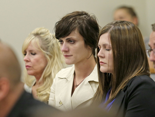 Linda Cluff, sister to Michelle MacNeill,  Alexis MacNeill Somers and Rachael MacNeill (left to right)  listen as their father (and former brother-in-law) Martin Joseph MacNeill is sentenced in a forcible sex abuse case by Judge Samuel D. McVey in Fourth District Court, MacNeill is also charged with killing his wife, Michelle MacNeill, in a separate case and is scheduled to be sentenced this Friday,  Monday, Sept. 15, 2014, in Provo.