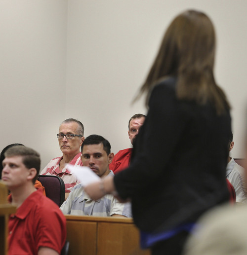 Martin Joseph MacNeill (background with glasses) watches as his daughter,  Alexis MacNeill Somers, walks to the stand to ask the judge to give her father the maximum sentence as he is sentenced in a forcible sex abuse case by Judge Samuel D. McVey in Fourth District Court, MacNeill is also charged with killing his wife, Michelle MacNeill, in a separate case and is scheduled to be sentenced this Friday,  Monday, Sept. 15, 2014, in Provo.