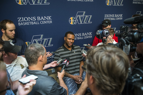 Chris Detrick  |  The Salt Lake Tribune Utah Jazz's Trevor Booker talks to reporters during a press conference at the Zions Bank Basketball Center Tuesday July 22, 2014.