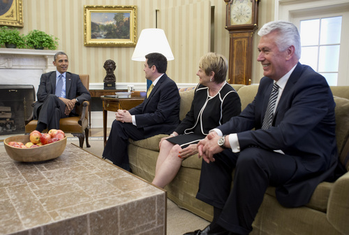 President Barack Obama meets with faith leaders, including, from second from left, Dr. Russell Moore of the Southern Baptist Convention, Suzii Paynter, executive coordinator, Cooperative Baptist Fellowship., and Dieter Uchtdorf of The Church of Jesus Christ of Latter-day Saints on Tuesday, April 15, 2014, in the Oval Office of the White House in Washington,. (AP Photo/Carolyn Kaster)