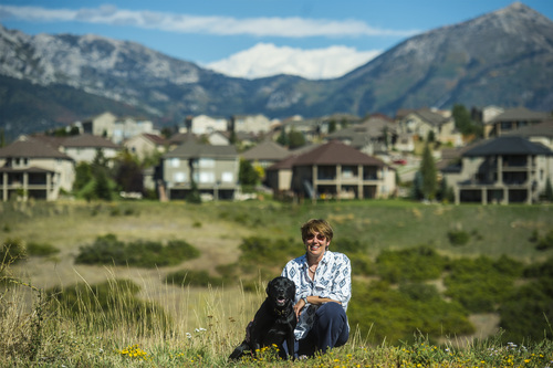 Chris Detrick  |  The Salt Lake Tribune Christine McClory and her dog Tuffy pose for a portrait in Traverse Ridge Wednesday September 17, 2014.