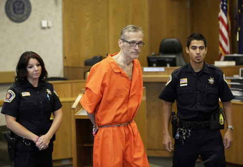 Martin MacNeill enters the courtroom before his sentencing Friday, Sept. 19, 2014, in Provo, Utah. MacNeill, a Utah doctor convicted of killing his wife in a trial that became a national true-crime cable TV obsession has been sentenced to 17 years to life in prison. MacNeill was found guilty of giving his wife drugs prescribed after cosmetic surgery and leaving her to drown in the bathtub of their home in 2007 so he could begin a new life with his mistress. (AP Photo/Rick Bowmer)