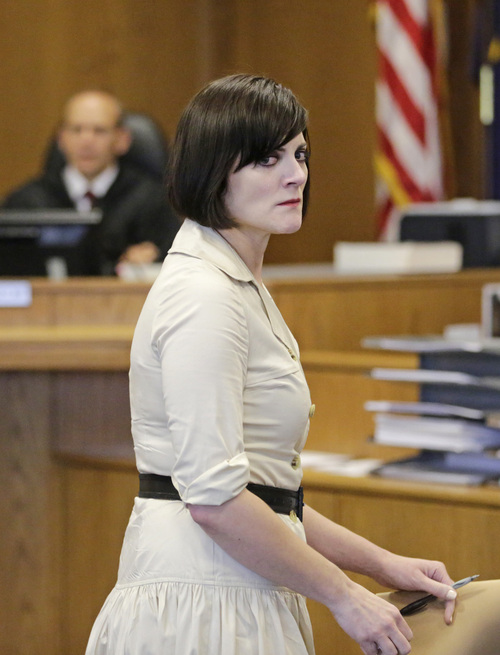 Martin MacNeill's daughter Rachel MacNeill stares at him after speaking during his sentencing Friday, Sept. 19, 2014, in Provo, Utah. MacNeill, a Utah doctor convicted of killing his wife in a trial that became a national true-crime cable TV obsession has been sentenced to 17 years to life in prison. MacNeill was found guilty of giving his wife drugs prescribed after cosmetic surgery and leaving her to drown in the bathtub of their home in 2007 so he could begin a new life with his mistress. (AP Photo/Rick Bowmer)