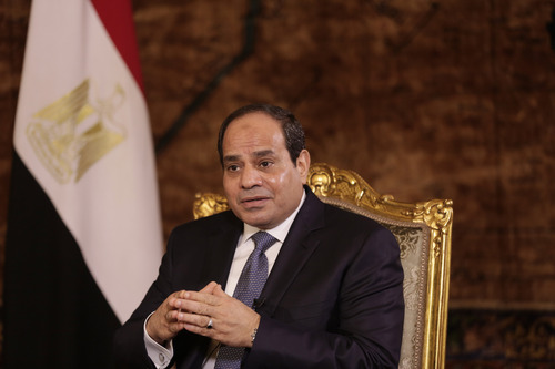 Egyptian President Abdel-Fattah el-Sissi speaks to The Associated Press during an interview at the presidential palace in Cairo, Saturday, Sept. 20, 2014. In his first interview with foreign media since taking office in June, el-Sissi has told AP he is prepared to give whatever support is needed in the fight against the Islamic State group but says military action is not the only answer. (AP Photo/Maya Alleruzzo)