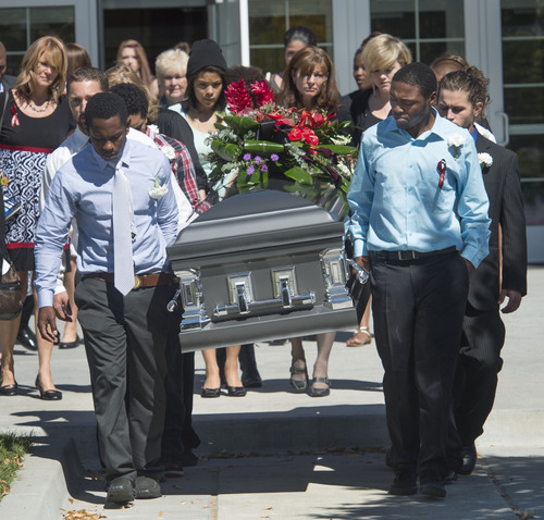 Steve Griffin  |  The Salt Lake Tribune  Family and friends serve as pallbearers as they carry the casket of Darrien Hunt following funeral services at the Saratoga Springs North Stake Center in Saratoga Springs, Utah Thursday, Sept. 18, 2014. Police officers in Saratoga Springs shot and killed Hunt on Sept. 10, 2014.