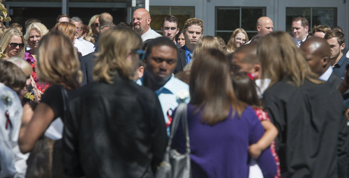 Steve Griffin  |  The Salt Lake Tribune  Family and friends watch as pallbearers carry the casket of Darrien Hunt following funeral services at the Saratoga Springs North Stake Center in Saratoga Springs, Utah Thursday, Sept. 18, 2014. Police officers in Saratoga Springs shot and killed Hunt on Sept. 10, 2014.