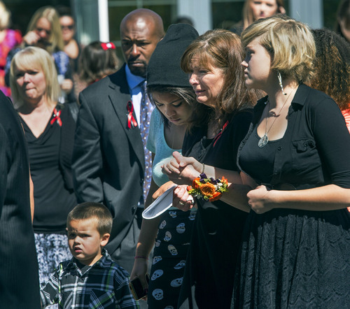 Steve Griffin  |  The Salt Lake Tribune  Susan Hunt is consoled as she follows pallbearers carrying the casket of her son, Darrien Hunt, after funeral services at the Saratoga Springs North Stake Center in Saratoga Springs, Utah Thursday, Sept. 18, 2014. Police officers in Saratoga Springs shot and killed Hunt on Sept. 10, 2014.
