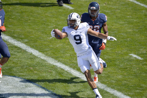 Chris Detrick  |  The Salt Lake Tribune Brigham Young Cougars wide receiver Jordan Leslie (9) scores a touchdown past Virginia Cavaliers cornerback DreQuan Hoskey (22) during the game at LaVell Edwards Stadium Saturday September 20, 2014.  Virginia is winning the game 16-13 at halftime.