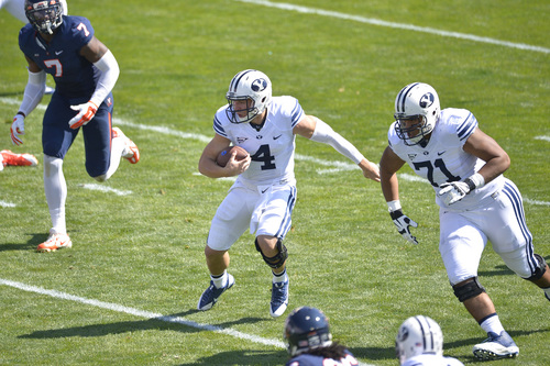 Chris Detrick  |  The Salt Lake Tribune Brigham Young Cougars quarterback Taysom Hill (4) runs the ball during the game at LaVell Edwards Stadium Saturday September 20, 2014.  Virginia is winning the game 16-13 at halftime.