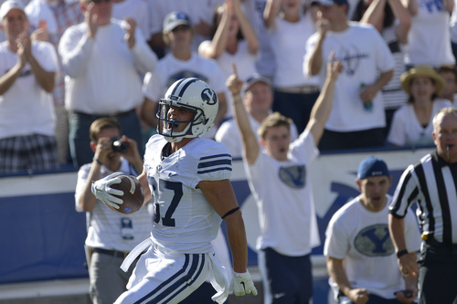 Chris Detrick  |  The Salt Lake Tribune Brigham Young Cougars wide receiver Mitchell Juergens (87) celebrates his touchdown during the second half of the game at LaVell Edwards Stadium Saturday September 20, 2014.  BYU won the game 41-33.