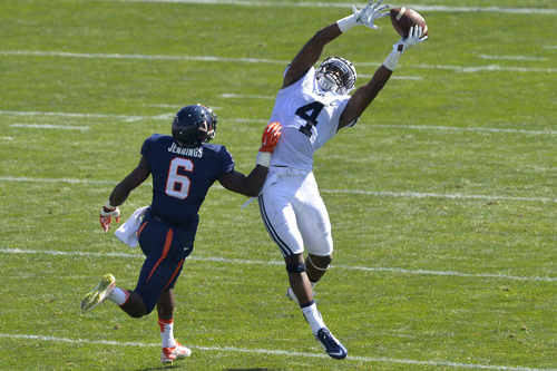 Chris Detrick  |  The Salt Lake Tribune Brigham Young Cougars defensive back Robertson Daniel (4) nearly intercepts the ball intended for Virginia Cavaliers wide receiver Darius Jennings (6) during the game at LaVell Edwards Stadium Saturday September 20, 2014.  Virginia is winning the game 16-13 at halftime.