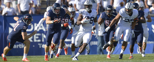 Chris Detrick  |  The Salt Lake Tribune Brigham Young Cougars running back Adam Hine (28) runs for a 100-yard touchdown during the second half of the game at LaVell Edwards Stadium Saturday September 20, 2014.  BYU won the game 41-33.
