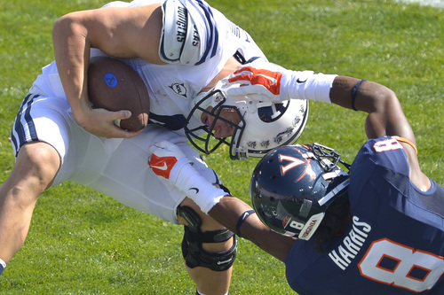 Chris Detrick  |  The Salt Lake Tribune Brigham Young Cougars quarterback Taysom Hill (4) is tackled by Virginia Cavaliers safety Anthony Harris (8) during the game at LaVell Edwards Stadium Saturday September 20, 2014. No flag was thrown on the play. Virginia is winning the game 16-13 at halftime.